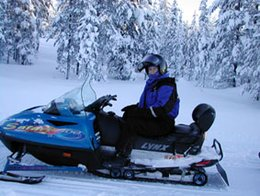 Picture of a snowmobile with a single rider